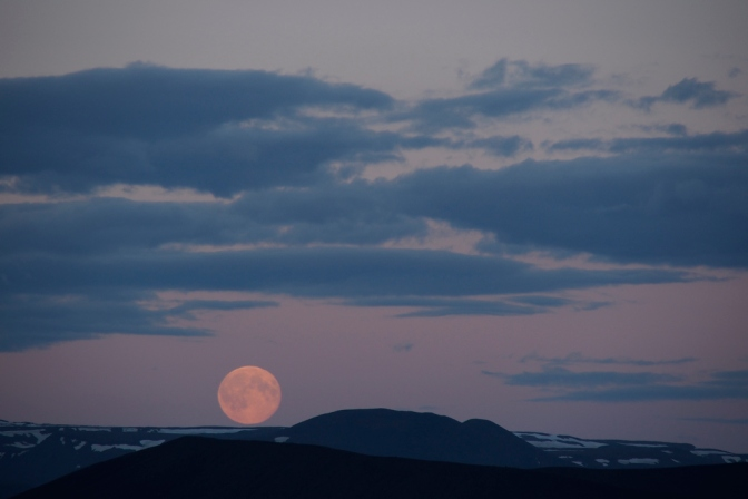 A midsummer full moon rising over Hverfjall Crater at Myvatn