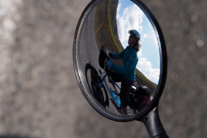 Jan cycling past me as seen through my rearview mirror