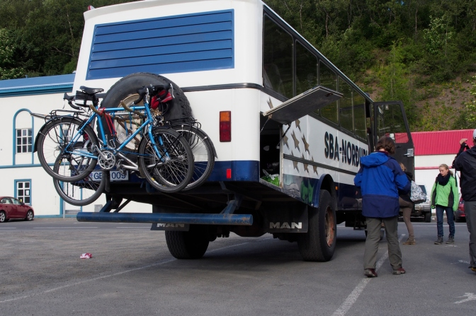 The bikes on the back of the bus