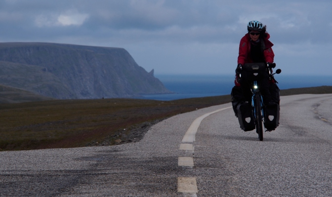 Jan leans into the wind to keep her balance while riding south from Nordkapp.