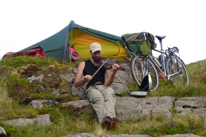 Jim playing his fiddle at our camp near Å.