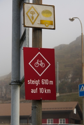A sign warning of the climb ahead to Oberalp Pass.