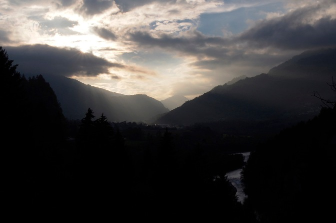 The light bursting through storm clouds above the Rhine gorge near Ilanz.