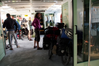 Jan with the bikes on the ferry to Punti Sabbioni.
