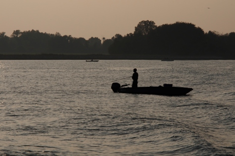 Fishing near Venice at sunset.