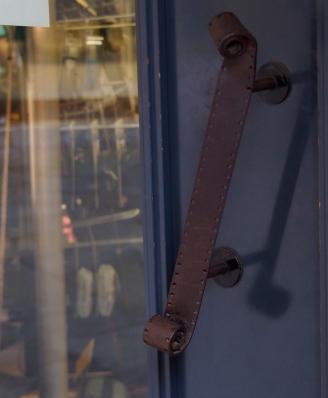 Door handle at a camera store.