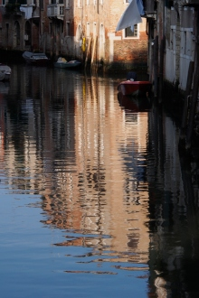 Venice canal reflection.