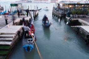 Gondolas coming out at Riva degli Schiavoni.
