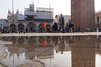 Water coming up through the manhole covers in Piazza San Marco.