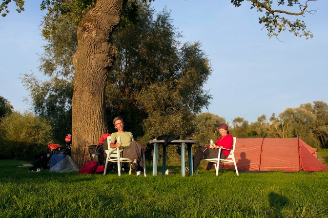Enjoying the sun at a canoe club campsite along the Danube River.