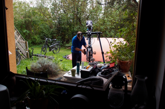 Tom working on the bikes in his back yard.