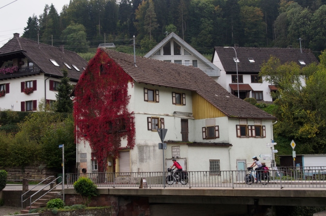 Jan and Tom riding through a village in the Black Forest.