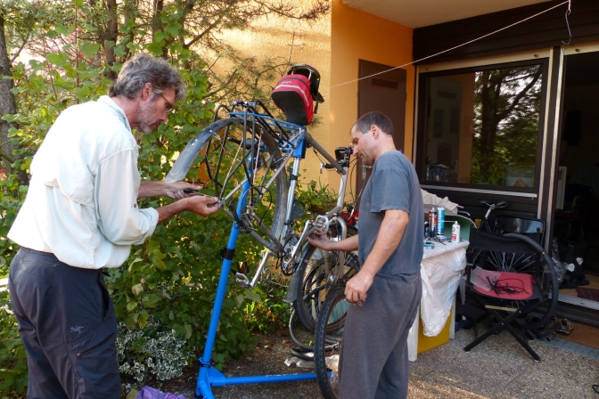 Tom and Paul working on the bikes.