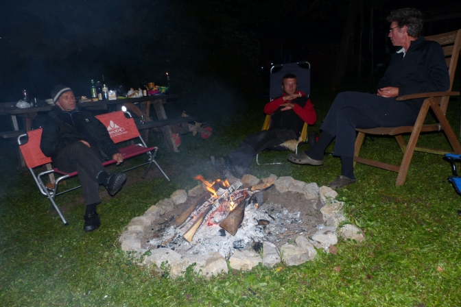 Tom, Wolfi and Paul drinking beer by the fire.