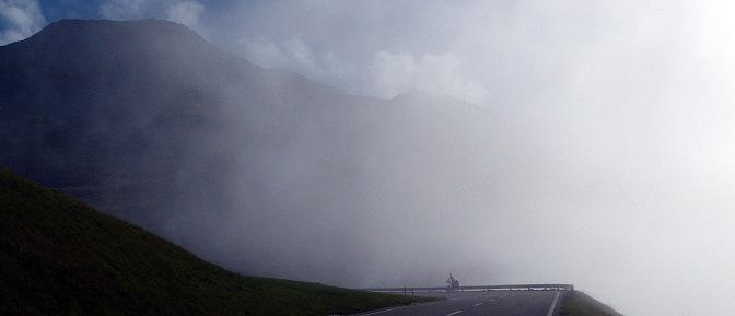 Paul climbing Oberalp Pass in the fog.