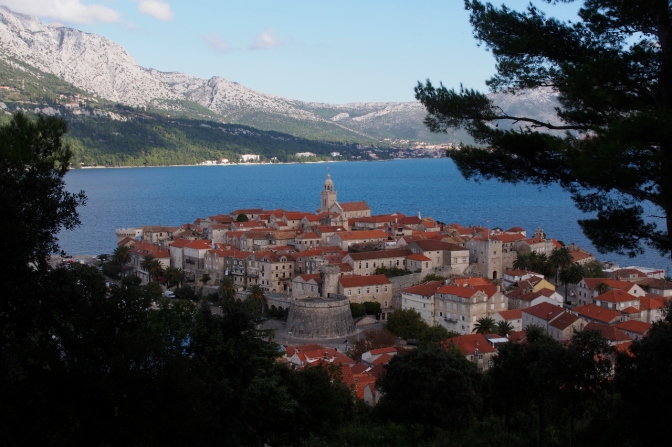 The walled city of Korčula with Pelješac peninsula in the background.