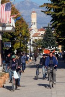 Cyclists in Shkodra along one of the main shopping streets..