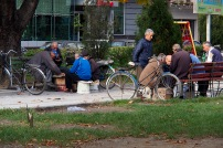 Men playing dominoes in a park in Shkodra.