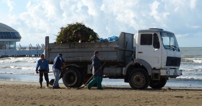 Cleaning up the garbage along the beach in Durrë's.