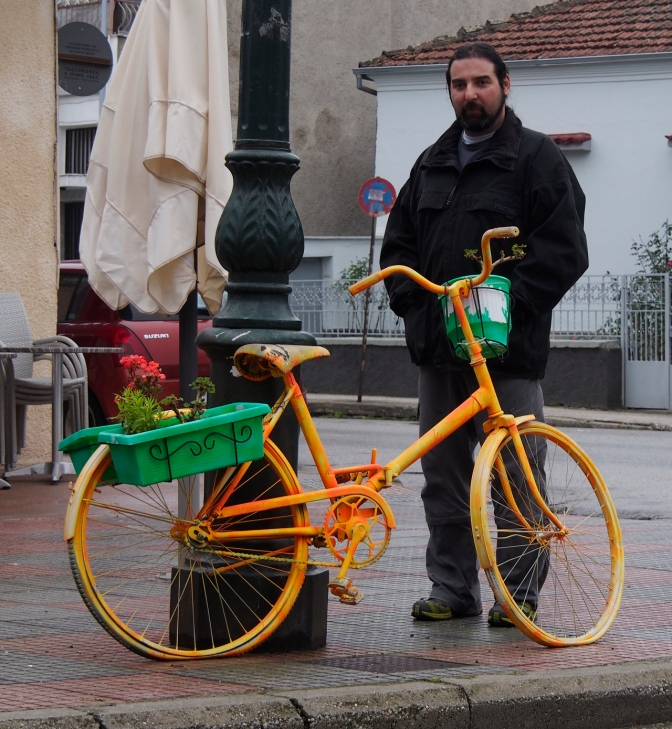 Yannis with one of the bicycle planters in Elassona.