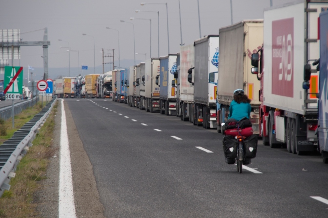 Riding past several kilometres of transport trucks waiting to cross the border in Turkey.