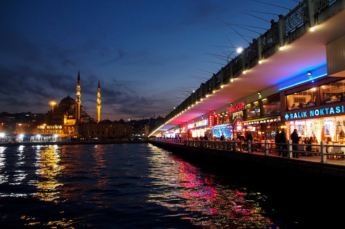 Galata Bridge Restaurants across the Golden Horn with Yeni Cami, the New Mosque, in the background.