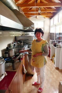 The cook in her kitchen.