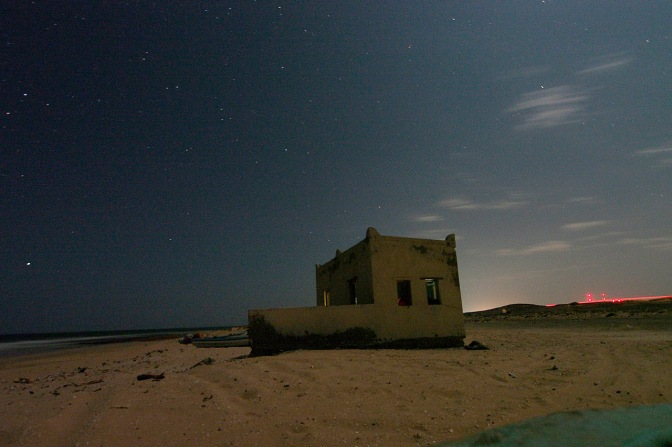 Our little mosque on the beach by night.