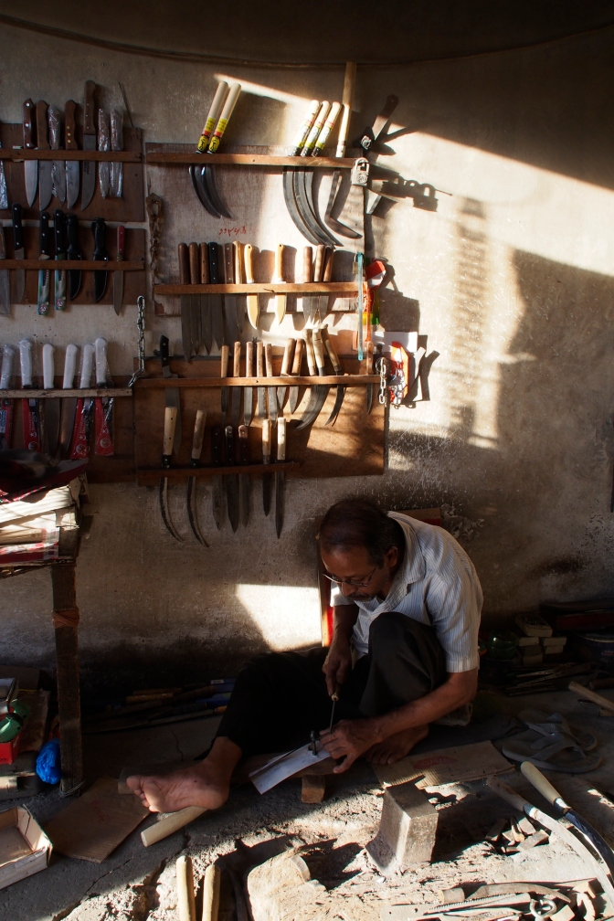 Knife maker in his workshop in Al-Hawiyah.