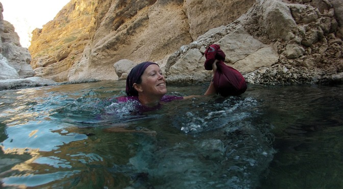 Jan swimming into Wadi Shab.