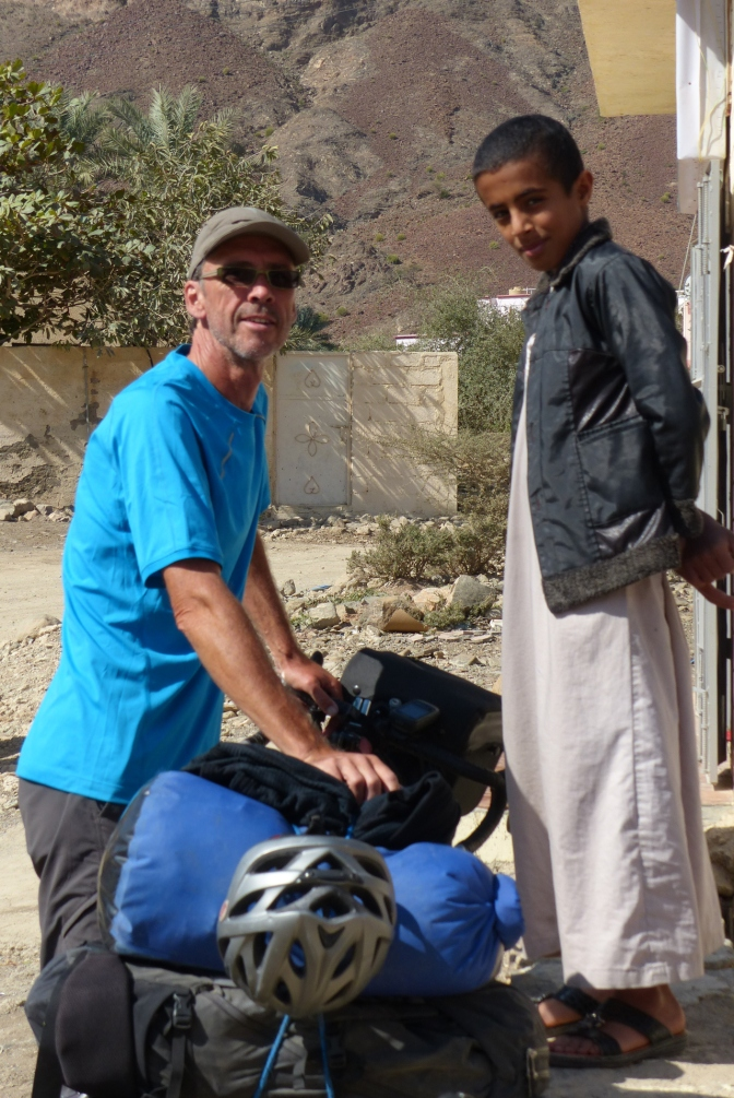 Paul with an inquisitive boy in a mountain village.