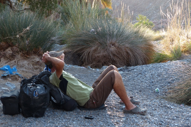 Relaxing after hiking into Wadi al Abyad.