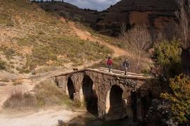 Crossing stone bridge in a canyon near Alquezar.
