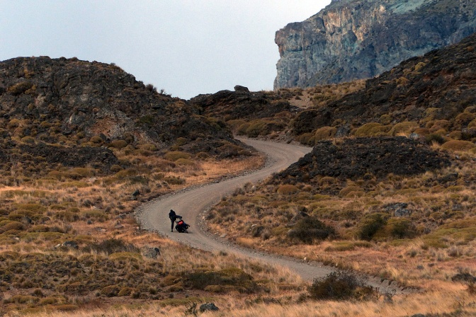 Paul is thrown off his bike as it slips out from under him in the soft gravel on a steep hill in the Chacabuco Valley.