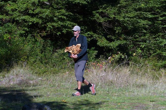 Paul hauling fire wood to camp at Lago Llanquihue.