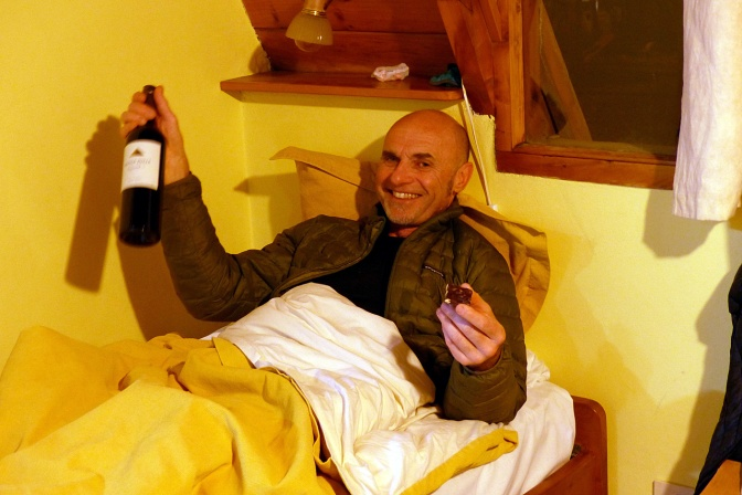 Frank with wine and chocolate in our cabaña in Villa La Angostura.