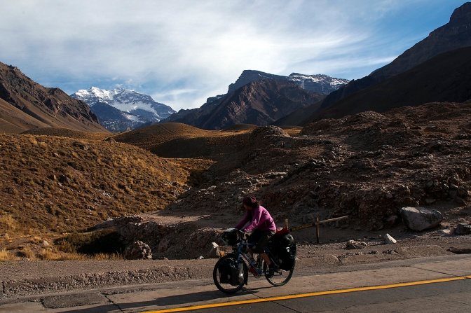 Jan riding past Aconcagua as we climb over 3,000 metres above sea level to the border with Chile.