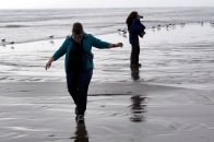Jan and Eleanor crossing a stream on La Serena beach.