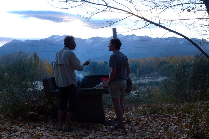 Paul and Cyrille chatting by the grill as the sun sets.
