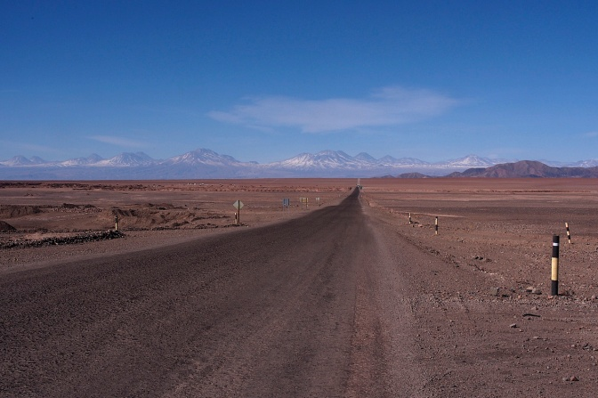 The road looks like it goes down but it's perfectly flat across the Salar De Atacama.