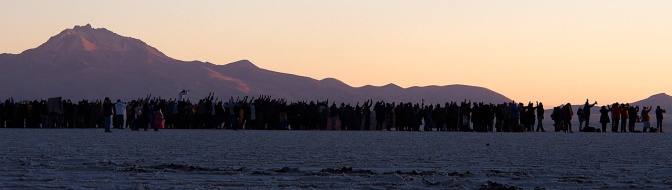 Hundreds of solstice partiers greeting the sunrise on June 21.