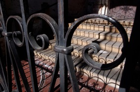 Wrought iron gate and shadows.
