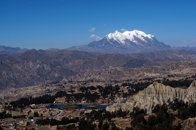 Looking down on the outskirts of La Paz with Illimani, 6,439 metres, looming over it.