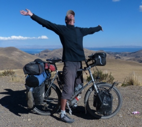 After two and a half hours and 27 km of climbing Paul celebrates arriving in the pass above Copacabana at 4,260 metres.