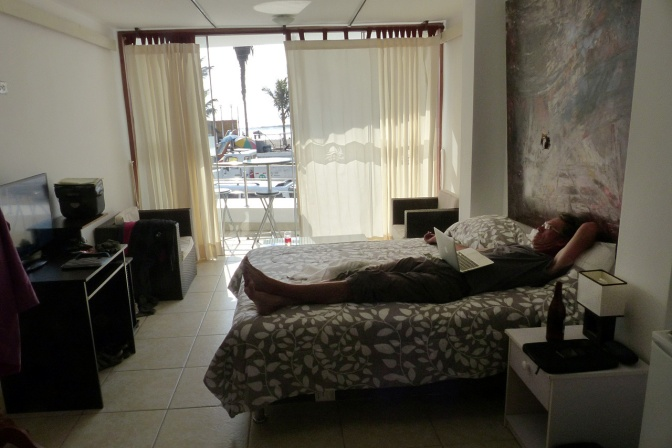 Paul relaxing in our Huanchaco hotel room.