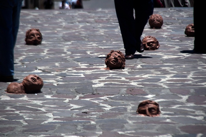 Pedestrians walk through a guerrilla art installation in Plaza San Fransisco.