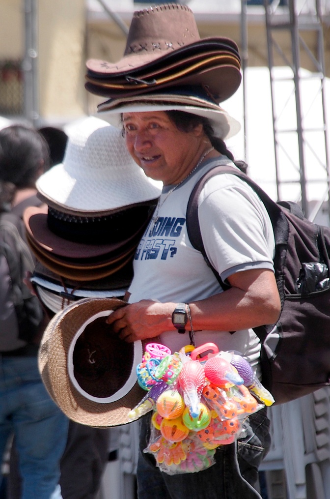 Selling hats, a much needed accessory to shield the intense equatorial sun.
