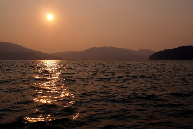 A smokey sunset over Whitefish Lake.