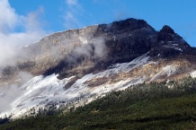 Fresh snow from an overnight storm on the mountains in Glacier National Park.