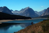 Hikers looking over Lake Shelburne in Many Glaciers.